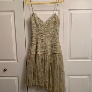 Spaghetti-strap, asymmetrical dress.